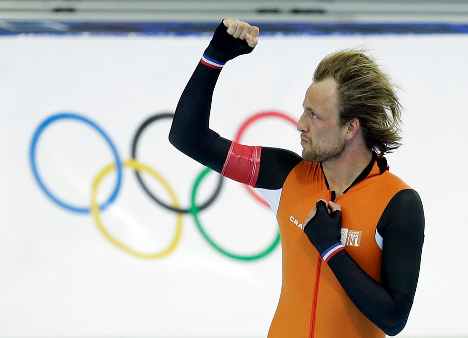 Gold medallist Michel Mulder from the Netherlands clenches his fist after his second heat race in the men's 500-meter speedskating race at the Adler Arena Skating Center during the 2014 Winter Olympics, Monday, Feb. 10, 2014, in Sochi, Russia. (AP Photo/Patrick Semansky) 2014 Sochi Olympic Games;Winter Olympic games;Olympic games;Spor