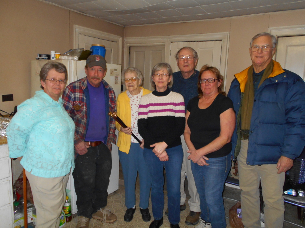 Cane presentation: From left are Carol Smith, Gary Taylor, Justine Taylor, Brenda Lovejoy, Selectman Paul Frederic, Karen Fatz and Selectman Joseph Miller.