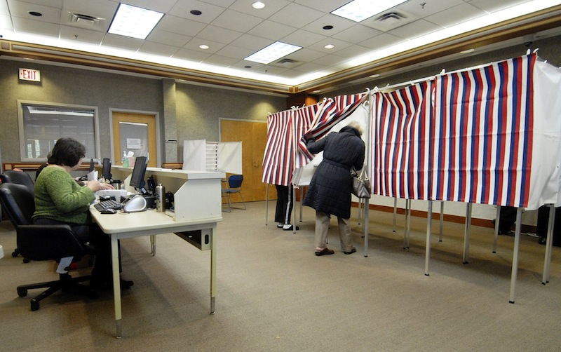 In this 2010 file photo, a resident takes advantage of early voting at the Scarborough Municipal Building. A bill proposing a constitutional amendment to allow an enhanced early-voting system in Maine fell short Wednesday in the House of Representatives. Election 2009