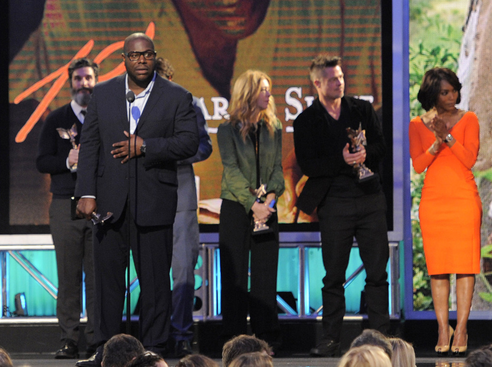 """Steve McQueen, second from left, accepts the best feature award for """"12 Years a Slave"""" along with, from left, Anthony Katagas, Dede Gardner, Brad Pitt and Angela Bassett on stage at the 2014 Film Independent Spirit Awards, on Saturday."""