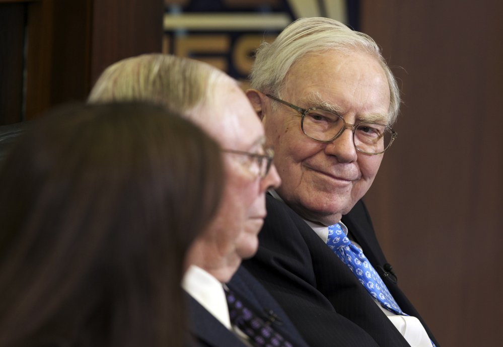Chairman and CEO Warren Buffett's Berkshire Hathaway company said on Saturday that fourth-quarter earnings rose 10 percent to nearly $5 billion .