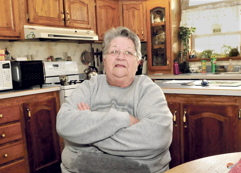 BAD NEWS: Judy Poulin, of Fairfield, shown at home Tuesday, said she was surprised and upset to hear about the suspension of the Farmshare program, which provides a subsidy to buy locally grown food. Poulin has been involved with the federal program for four years.