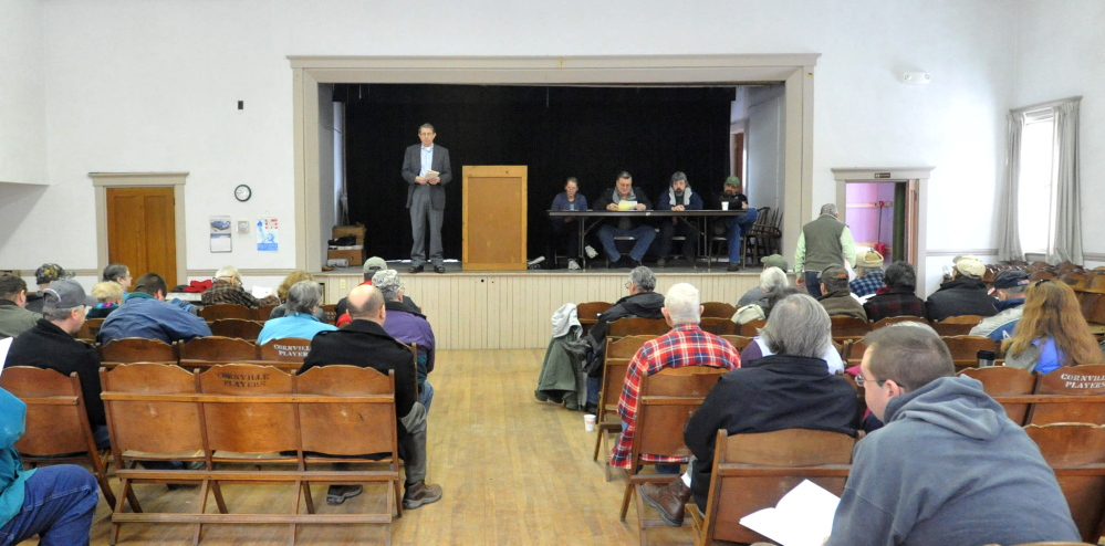 Motion MEETING: Residents of Cornville listen to a motion during the annual Town Meeting at the Cornville Town Hall on Saturday.