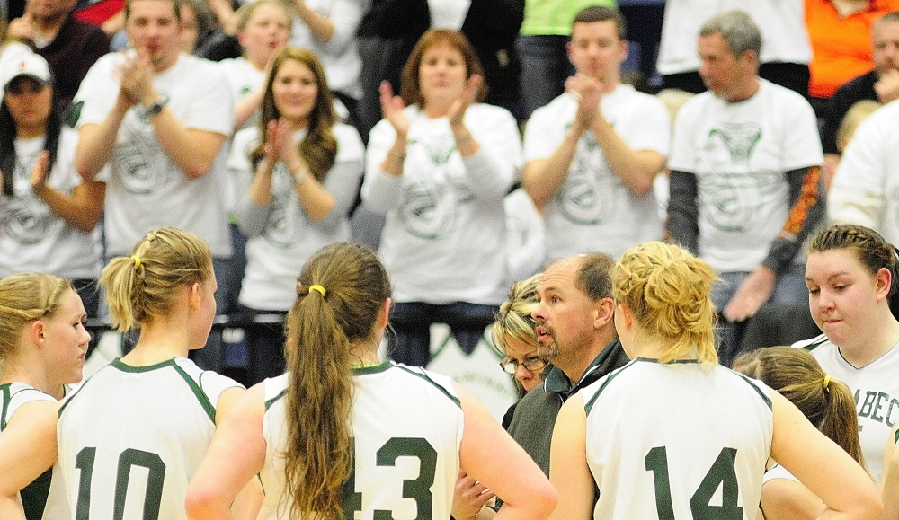Game time: Carrabec coach Skip Hugh talks to Cobras while fans cheer them on during a time out in second half of the Class C state championship game on Saturday at Augusta Civic Center.