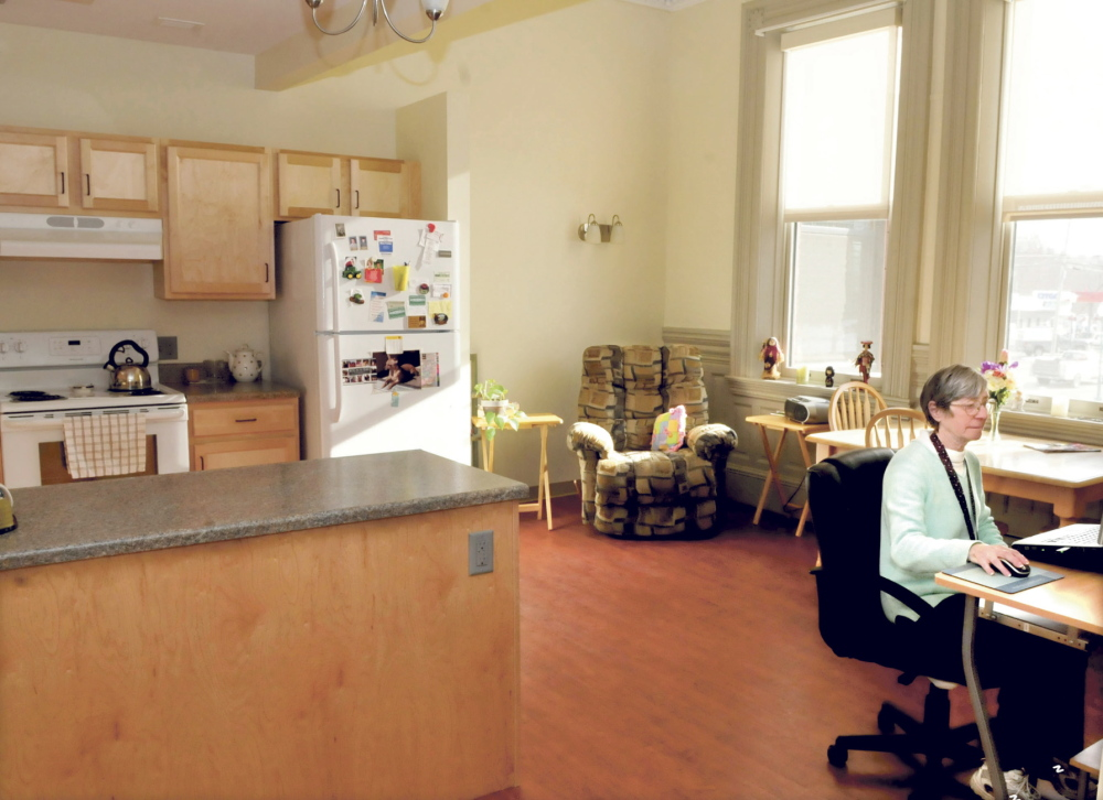 "COMFORTABLE: Mary Edna Dixon works on her computer in her spacious and bright apartment at the recently renovated Gerald Hotel in Fairfield. ""I love this place,"" Dixon said."