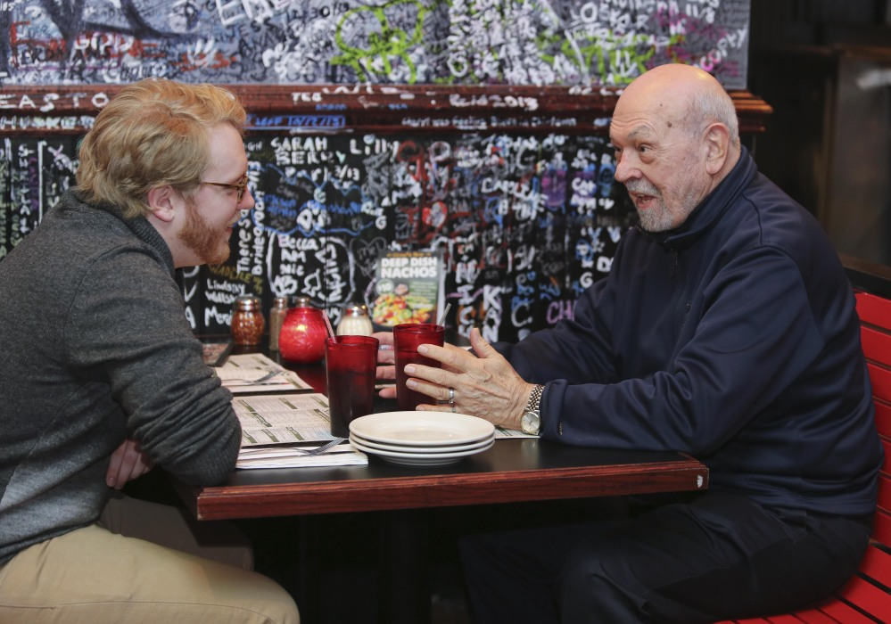 Northwestern University medical student Jared Worthington eats lunch with retired physician Dan Winship in Chicago. About 75 percent of Northwestern students who participate in the buddy program become doctors in fields that deal with Alzheimer's patients, said program director Darby Morhardt.