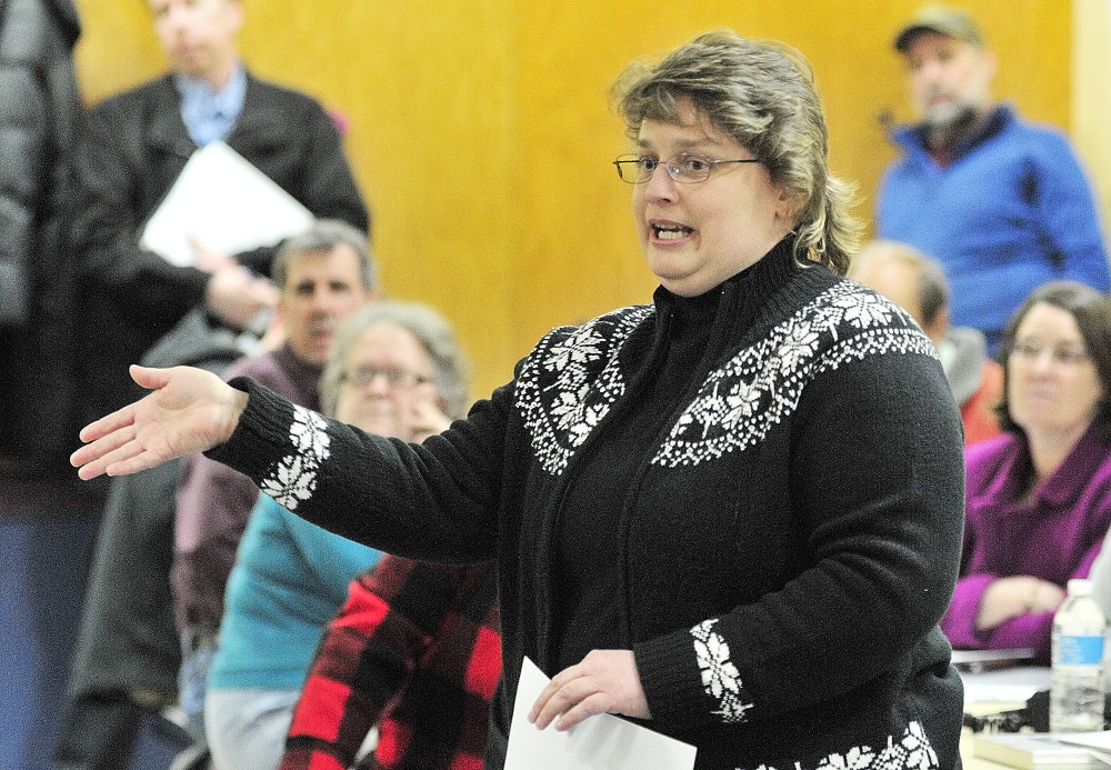 WORRIED ABOUT CRASHES: Paula Gravelle, who said she lives near the West Gardiner service plaza, talks about accidents during a public meeting held Tuesday at Helen Thompson School in West Gardiner by the state Department of Transportation to hear reaction to a planned roundabout.