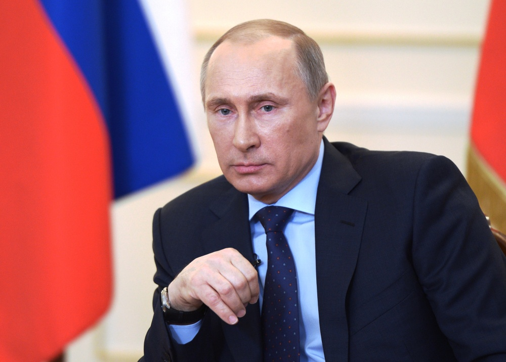 Russian President Vladimir Putin listens to journalists' questions on the current situation in Ukraine outside Moscow on Tuesday. It would be a risky proposition for him to cut off natural gas supplies to Ukraine.