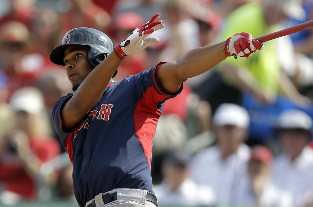 BIG HIT: Boston Red Sox shortstop Xander Bogaerts watches his two-run home run during the sixth inning Wednesday of an exhibition game against the St. Louis Cardinals in Jupiter, Fla. The Cardinals won 8-6.