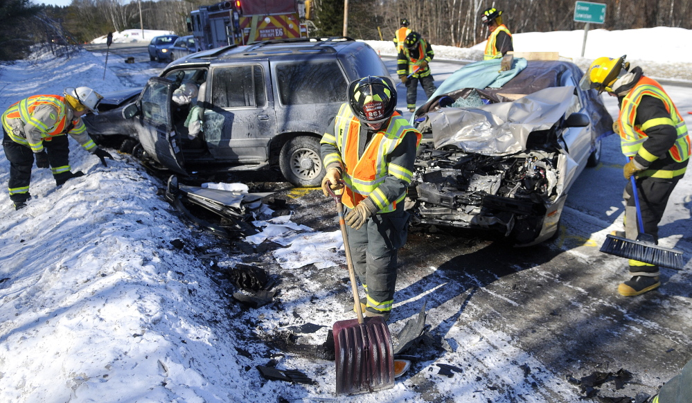 MONMOUTH CRASH: Monmouth firefighters collect debris from a two-car collision that killed a woman Thursday morning on U.S. Route 202 in Monmouth.