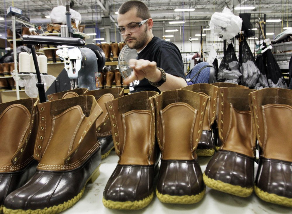 Eric Rego assembles boots in L.L. Bean's Brunswick plant. The company reports strong sales of its boots as part of its increase in revenues.