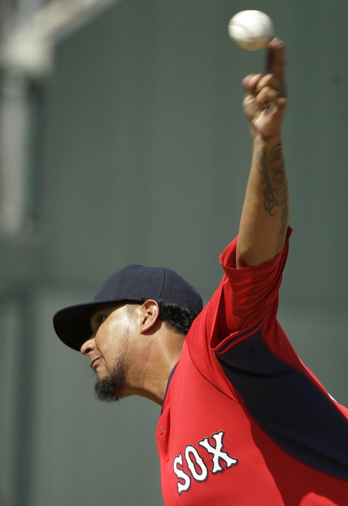 Boston Red Sox pitcher Felix Doubront delivers a warm-up pitch in the fourth inning against the Atlanta Braves on Friday.