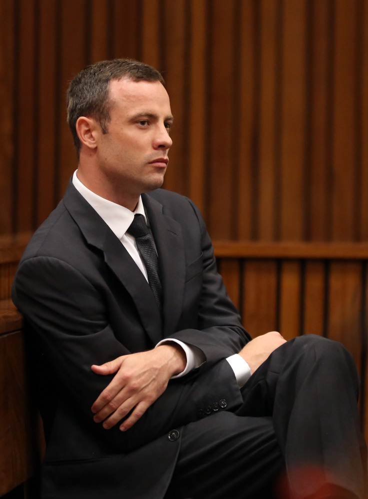 Oscar Pistorius sits in the dock during his trial at the high court in Pretoria, South Africa, on Friday. He is charged with murder for the shooting death of his girlfriend, Reeva Steenkamp, on Valentines Day in 2013.