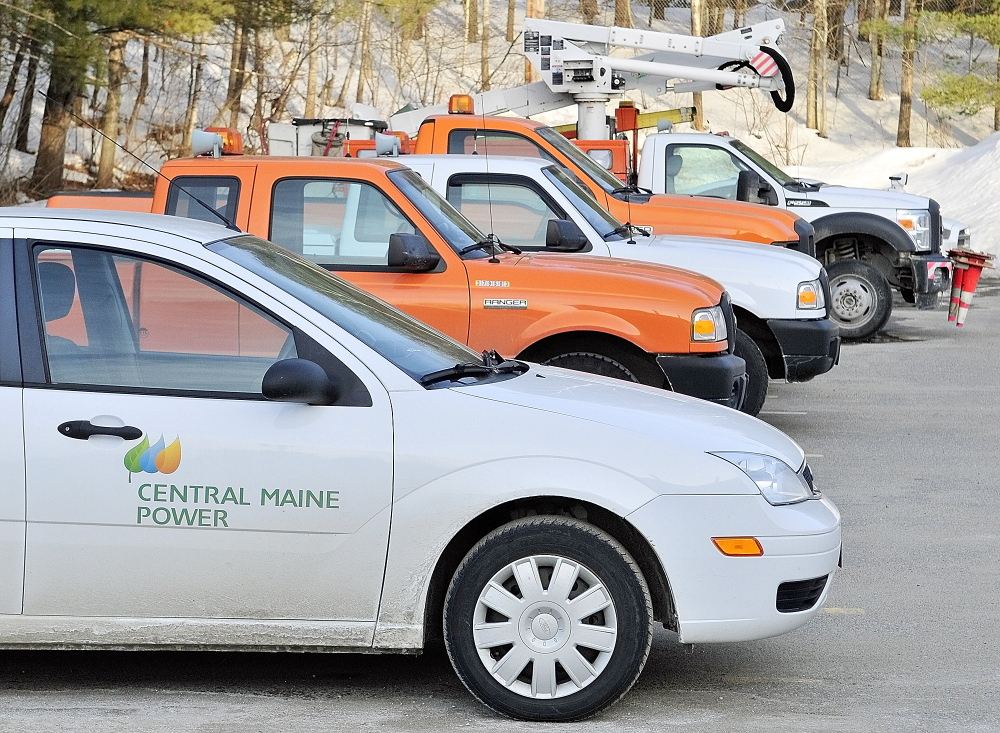 CMP Fleet: Rows of vehicles are parked on Friday at Central Maine Power's Augusta Service Building on Old Winthrop Road. A bill proposed by a Farmington representative would require CMP to register its vehicles in various towns across the state, which would cost the city hundreds of thousands of dollars, according to city officials.