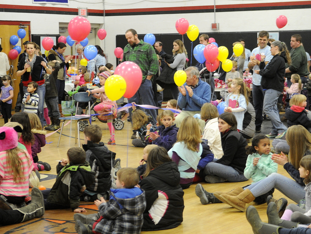 HEARTS FOR EZRA: Those attending Sunday's Hearts for Ezra Auction and Fundraiser at Hall-Dale High School listen to a concert Sunday, one of many features of the kid-friendly event. Money raised assists in researching a cure for spinal muscular atrophy.