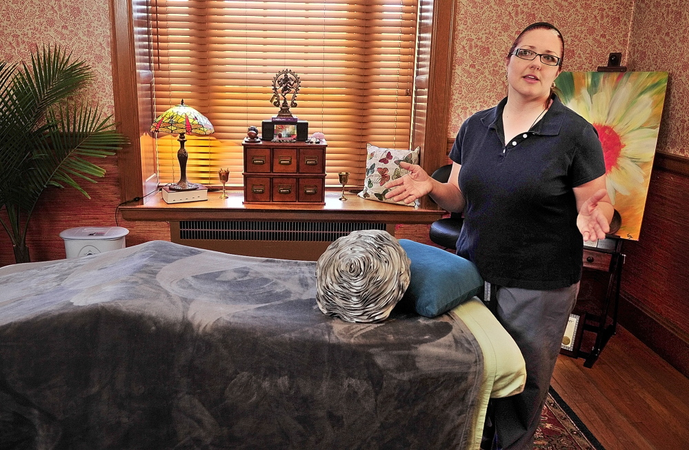NEW BUSINESS, OLD SPACE: Teresa Zardus talks about her plans for her new business on Thursday at Zardus Art of Massage and Wellness Spa in Gardiner. It is at 1 Lincoln St. in the former St. Joseph's rectory on the Gardiner Common.