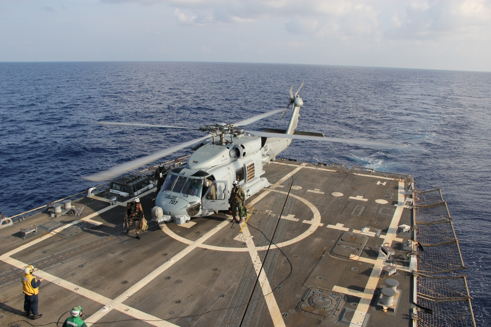 A U.S. Navy helicopter lands aboard Destroyer USS Pinckney during a crew swap before returning to a search and rescue mission for the missing Malaysian airlines flight MH370 in the Gulf of Thailand on Sunday. Scores of ships and aircraft from several countries continued to hunt for the plane and the 227 passengers and 12 crew members on board.