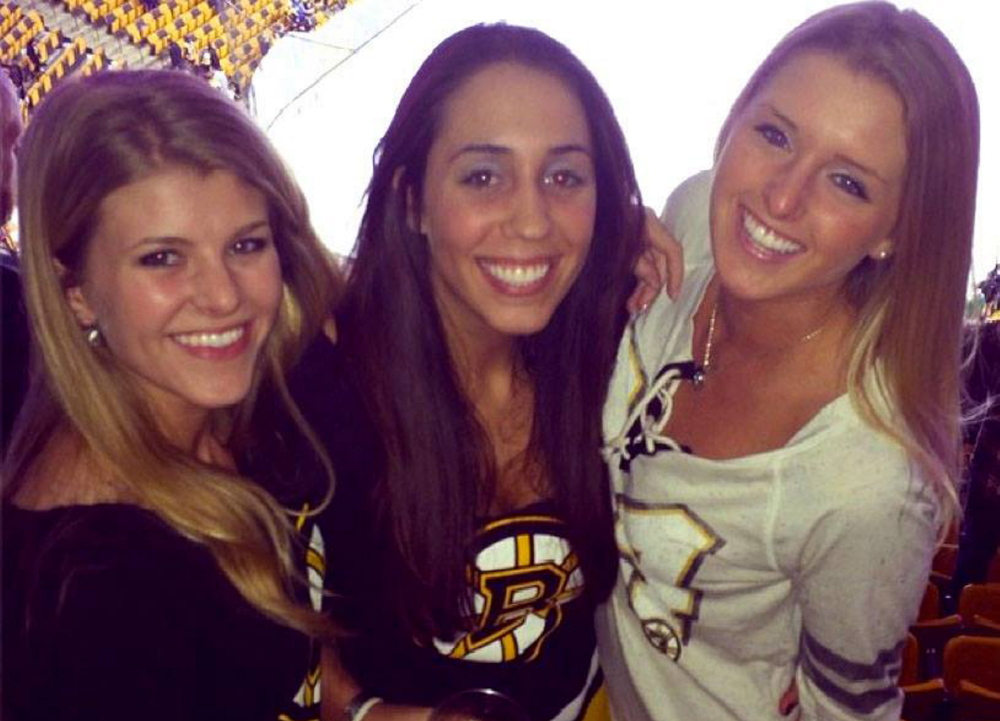 From left, Sabina Grasso, Caitlynn Brown and Anna McDonough pose at TD Garden Thursday before a game at which Grasso and McDonough were injured.