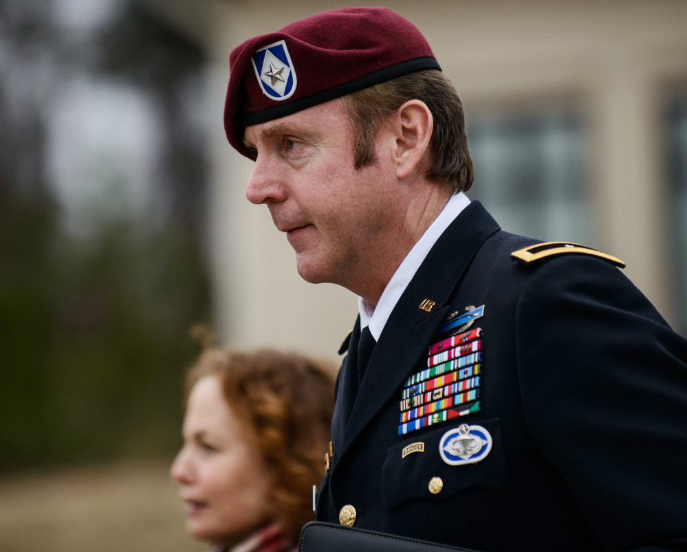 Brig. Gen. Jeffrey Sinclair leaves the courthouse at Fort Bragg, N.C., in this March 4, 2014, photo. He has admitted to having an affair with a female subordinate but has denied assaulting her.
