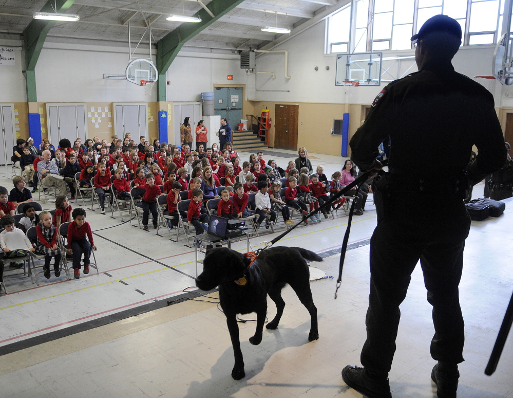 """As seen on TV: District Game Warden Kristopher MacCabe talks Wednesday to St. Michael School students in Augusta. The Monmouth native is featured in the television show """"North Woods Law."""""""