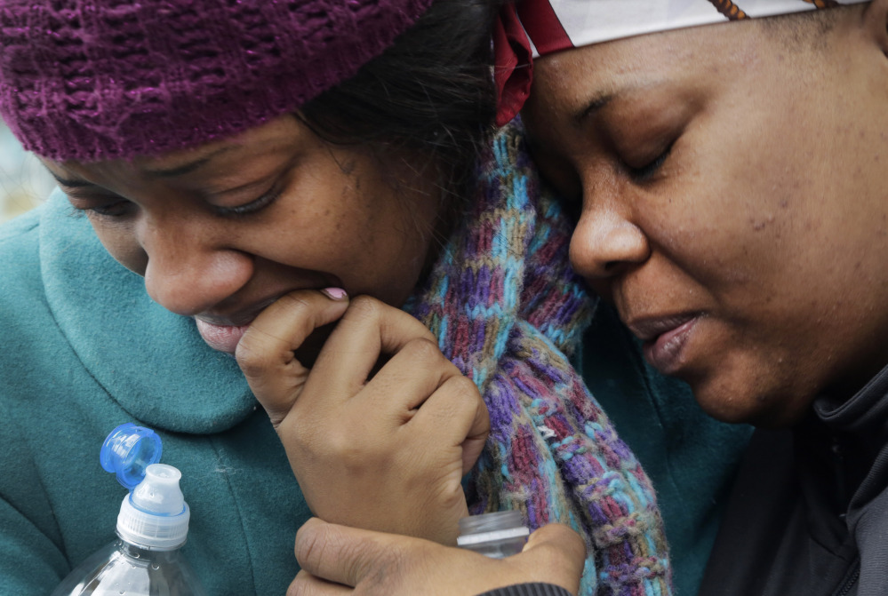 Alecia Thomas, left, is comforted by a friend, Shivon Dollar, after she lost her home following an explosion that leveled two apartment buildings in the East Harlem neighborhood of New York City on Wednesday.