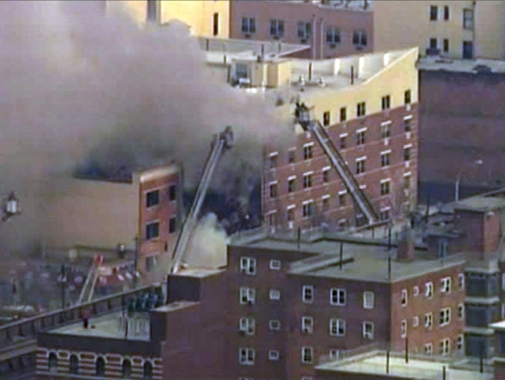 In this image taken from WABC-TV video, firefighters battle a blaze at the site of a reported explosion and building collapse in the East Harlem neighborhood of New York on Wednesday.
