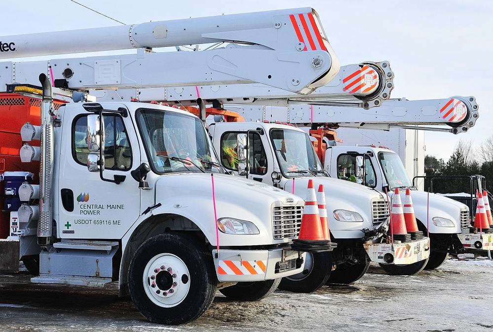 FLEET FIGHT: Rows of vehicles are parked Friday at Central Maine Power Co.'s Augusta Service Building on Old Winthrop Road in Augusta. A bill heard by lawmakers Wednesday would require utilities to register their vehicles where they are parked.