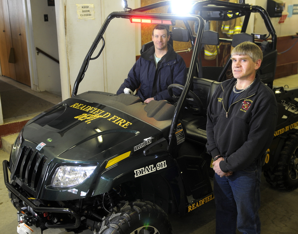 Staff photo Andy Molloy COMMUNITY SUPPORT: Readfield Fire Department Capt. Jason Foster, left, and Chief Lee Mank say the new utility task vehicle the department bought was paid for entirely by money raised by the community.
