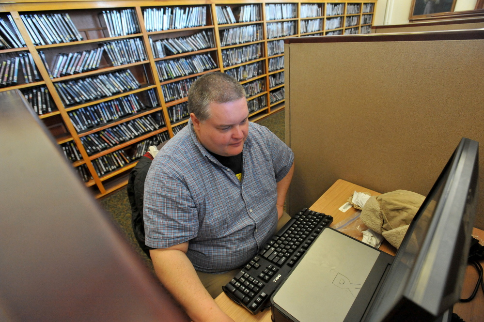 WORLD WIDE WEB: Corey Hewins surfs the World Wide Web at the Waterville Public Library on Friday, March 14, 2014, searching for vacation destinations in California.
