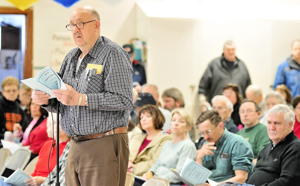 His opinion: Robert Bender speaks on Saturday during a debate at the Pittston Town Meeting in the Pittston Consolidated School.