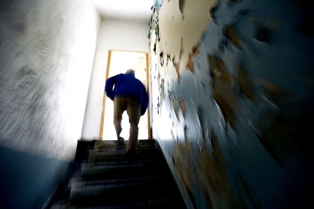 Don Gean of the York County Shelter Program walks up the stairway in the old jail in Alfred where he began his work with southern Maine's homeless, spending the next decades finding innovative ways to address all their needs.