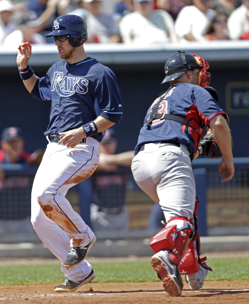 TOUGH DAY: Tampa Bay Rays Ben Zobrist (18) scores as Boston Red Sox catcher David Ross (3) covers the plate on a two run RBI double by James Loney in the fifth inning Sunday of an exhibition game in Port Charlotte, Fla. The Rays won 8-4.