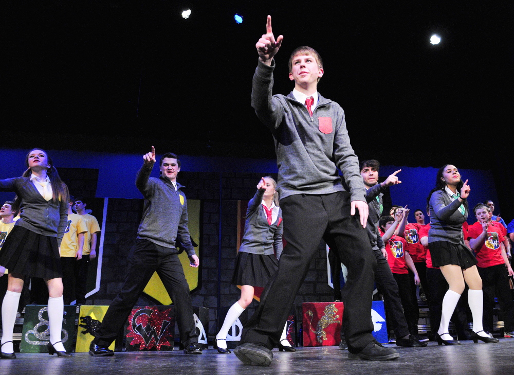 "Looking ahead: Josh Cormier sings ""Baby You Fly My Car"" during a Chizzle Wizzle rehearsal Friday at Cony High School in Augusta. The show has a Harry Potter theme and the song was an adaption of the Beatles song ""Baby You Can Drive My Car."""