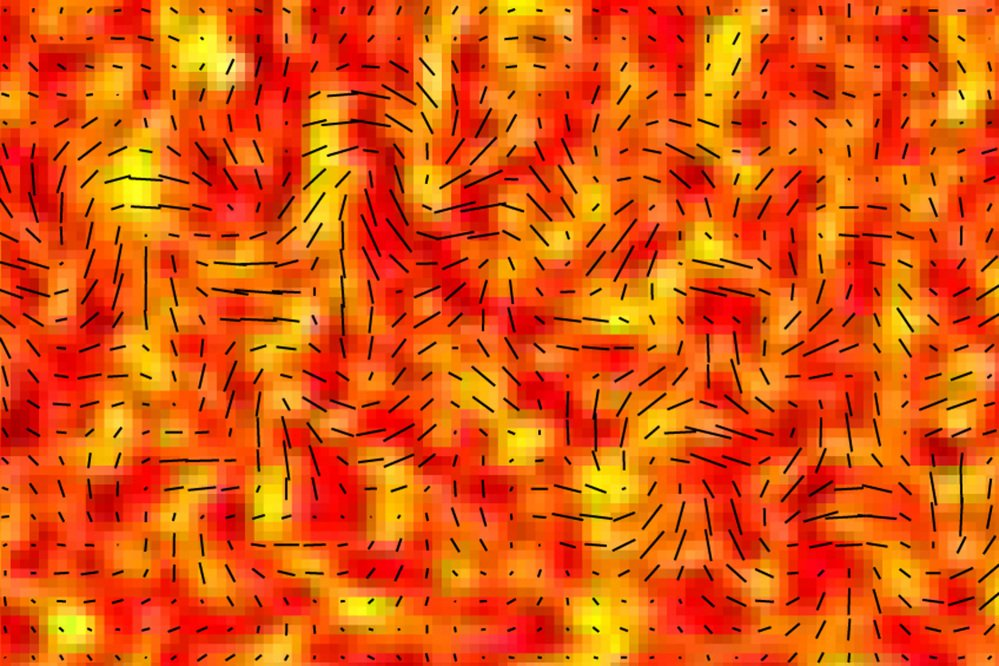This image provided by the BICEP2 Collaboration shows slight temperature fluctuations, indicated by variations in color, of the cosmic microwave background of a small patch of sky and the orientation of its polarization, shown as short black lines. Researchers say since the cosmic microwave background is a form of light, it exhibits all the properties of light, including polarization. The changes in a particular type of polarization, indicated here, are theorized to be caused by gravitational waves. These waves are signals of an extremely rapid inflation of the universe in its first moments.