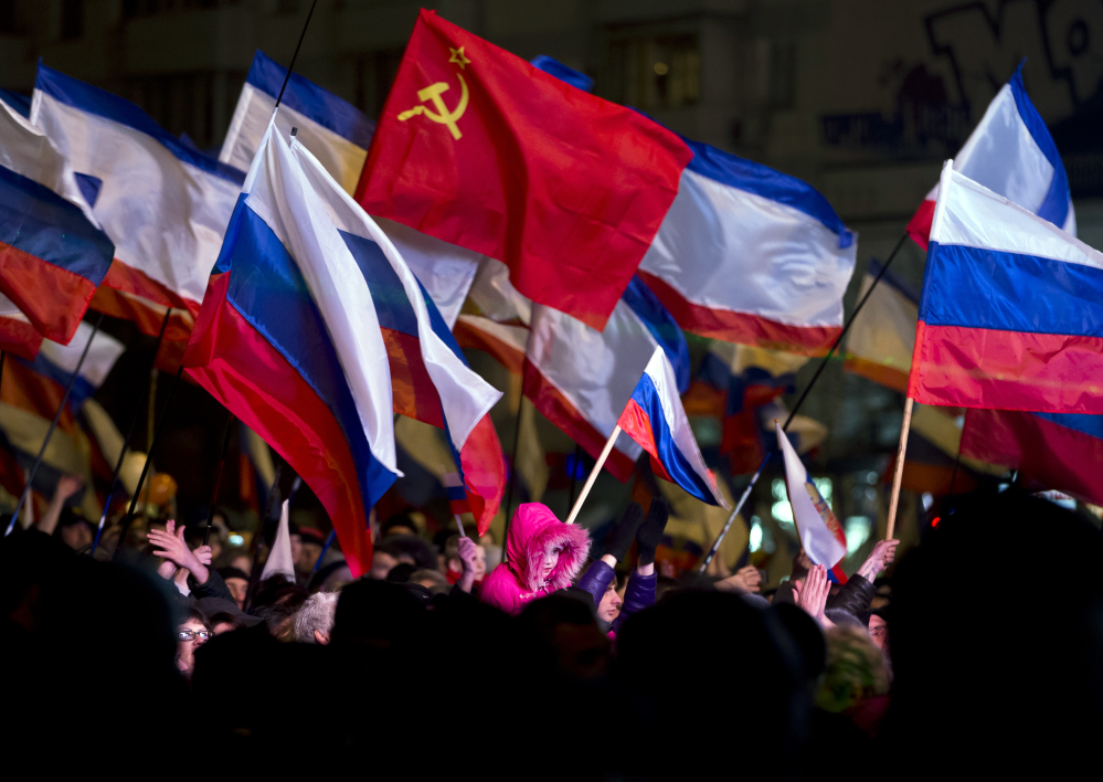 Pro-Russian people celebrate in Lenin Square, in Simferopol, Ukraine, on Sunday. Fireworks exploded and Russian flags fluttered above jubilant crowds after residents in Crimea voted overwhelmingly to secede from Ukraine and join Russia.
