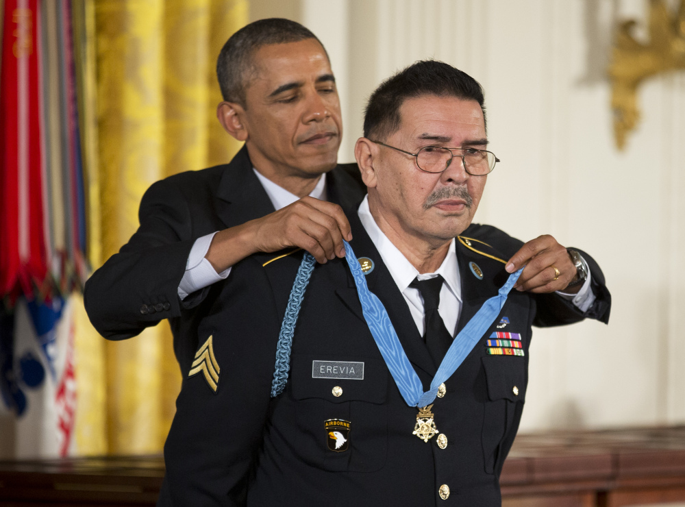 President Barack Obama awards Army Spc. Santiago Erevia the Medal of Honor during a ceremony in the East Room of the White House in Washington, Tuesday, March 18, 2014.
