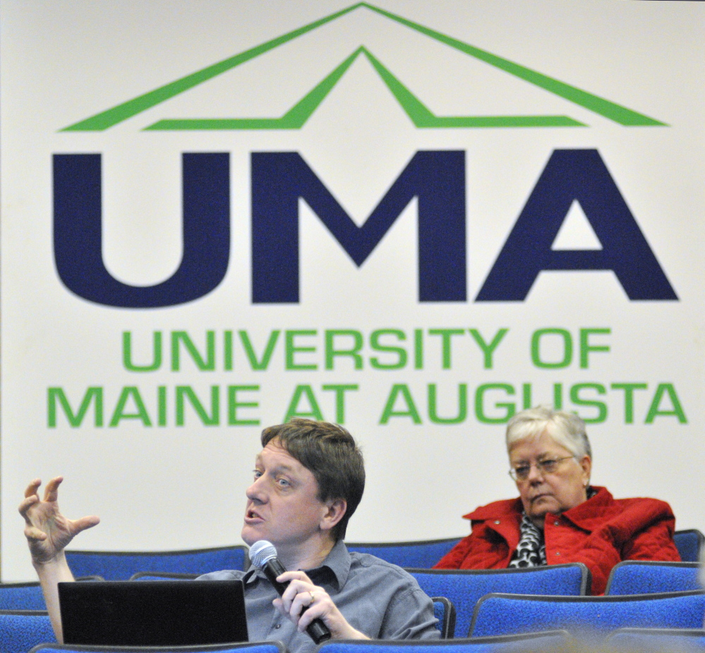 UMA cuts: James Cook, a social sciences professor, asks a question during a meeting about proposed budget cuts on Wednesday in Jewett Hall at the University of Maine at Augusta.