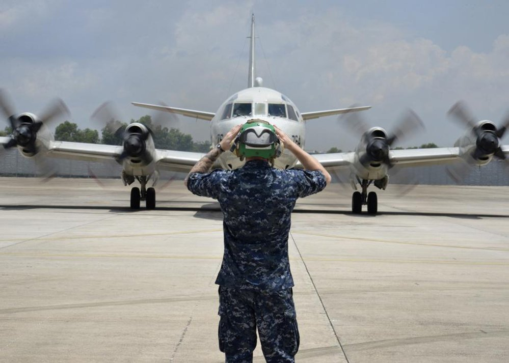 In this Monday, March 17, 2014 photo released by U.S. Navy, a sailor assigned to Patrol Squadron (VP) 46 prepares to launch a P-3C Orion before its mission to assist in search and rescue operations for Malaysia Airlines Flight 370 in Kuala Lumpur, Malaysia. New radar data from Thailand gave Malaysian investigators more potential clues Wednesday, March 19 for how to retrace the course of the missing Malaysian airliner, while a massive multinational search unfolded in an area the size of Australia. Cmdr. William Marks, a spokesman for the U.S. Navy's 7th Fleet, said finding the plane was like trying to locate a few people somewhere between New York and California.