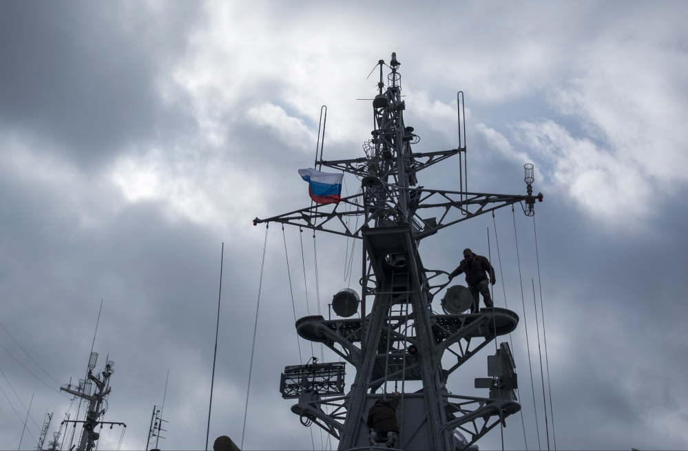 Pro-Russian forces raise a Russian flag after seizing the Ukrainian corvette Khmelnitsky in Sevastopol, Crimea, Thursday.