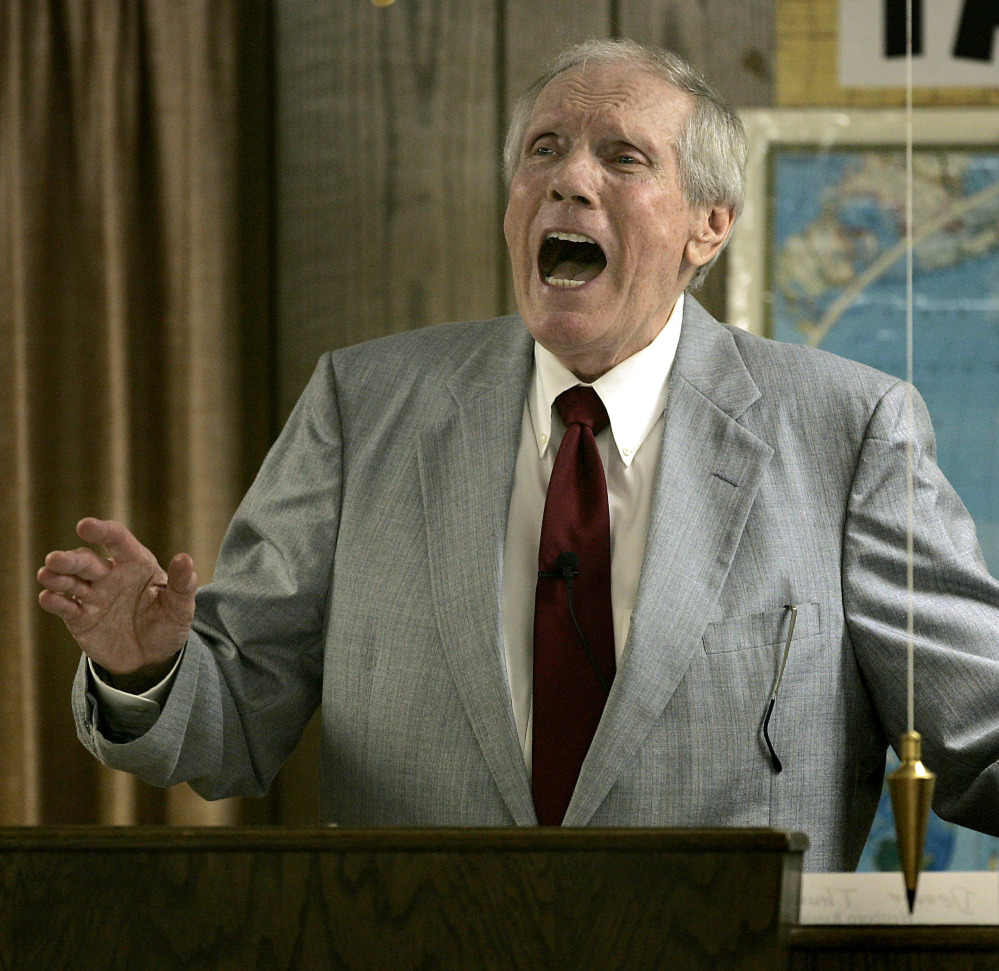 The Rev. Fred Phelps Sr. preaches at his Westboro Baptist Church in Topeka, Kan., in this 2006 file photo.
