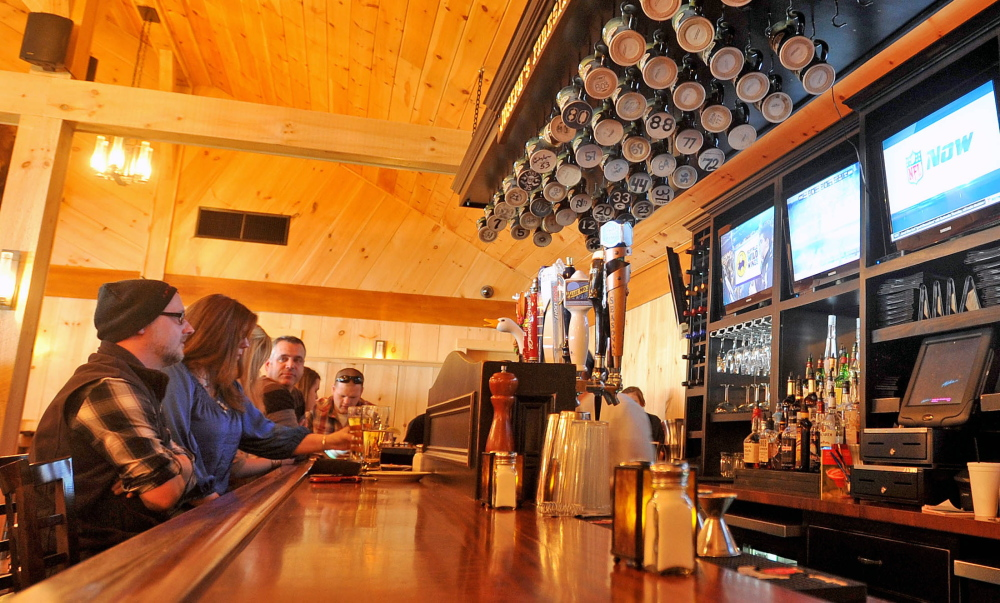 NO DECLINE: A couple sits at the bar at Joseph's Fireside Steakhouse on River Road in Waterville on Friday. Overall statewide revenues were down for the restaurant industry but local restaurants didn't feel the squeeze as much.
