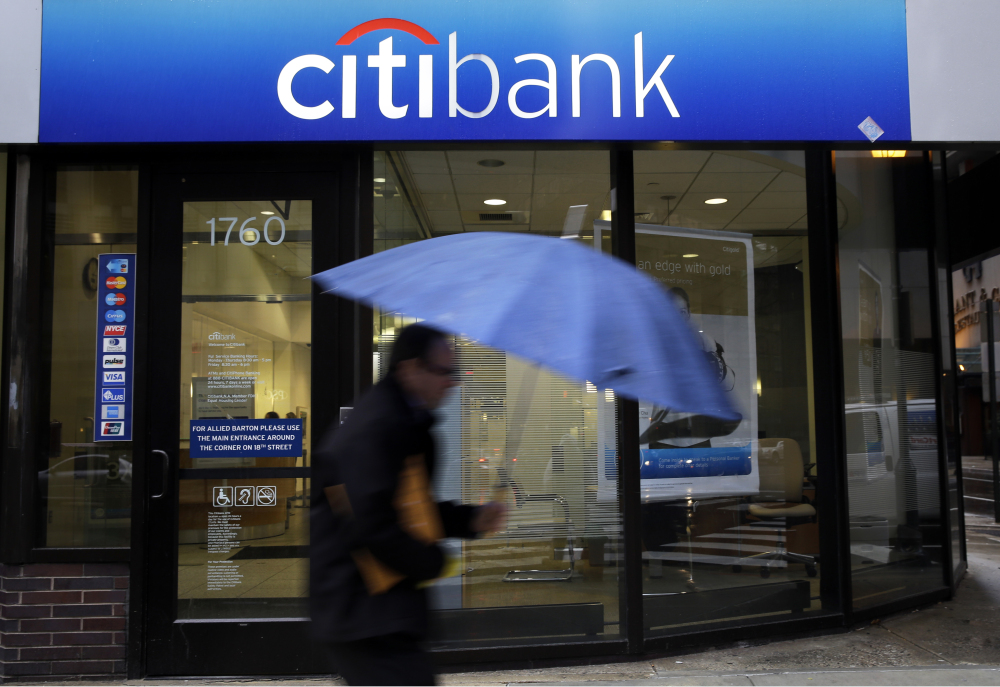 A person walks past a Citibank location in Philadelphia recently. Citigroup Inc., the parent of Citibank, was one of 30 major American banks that passed the Fed's stress test. The Fed will announce next week whether it has approved each bank's request, if one has been made, to raise dividends for shareholders.