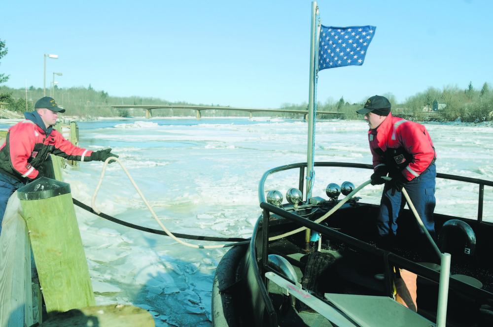 breaking the ice: Coast Guard cutter Bridle crew members Kyle Shute, left, and Steven Boyd untie their vessel from a bulkhead in Gardiner in this 2010 file photo.