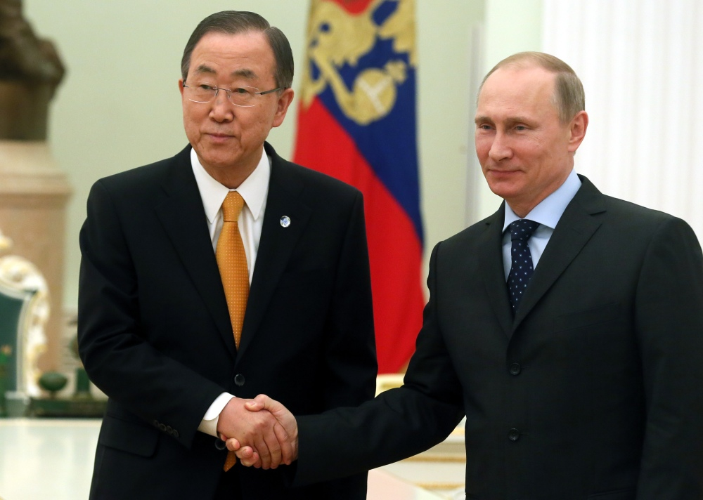 United Nations Secretary General Ban Ki-moon, left, shakes hands with Russian President Vladimir Putin during a meeting in Moscow's Kremlin Thursday.