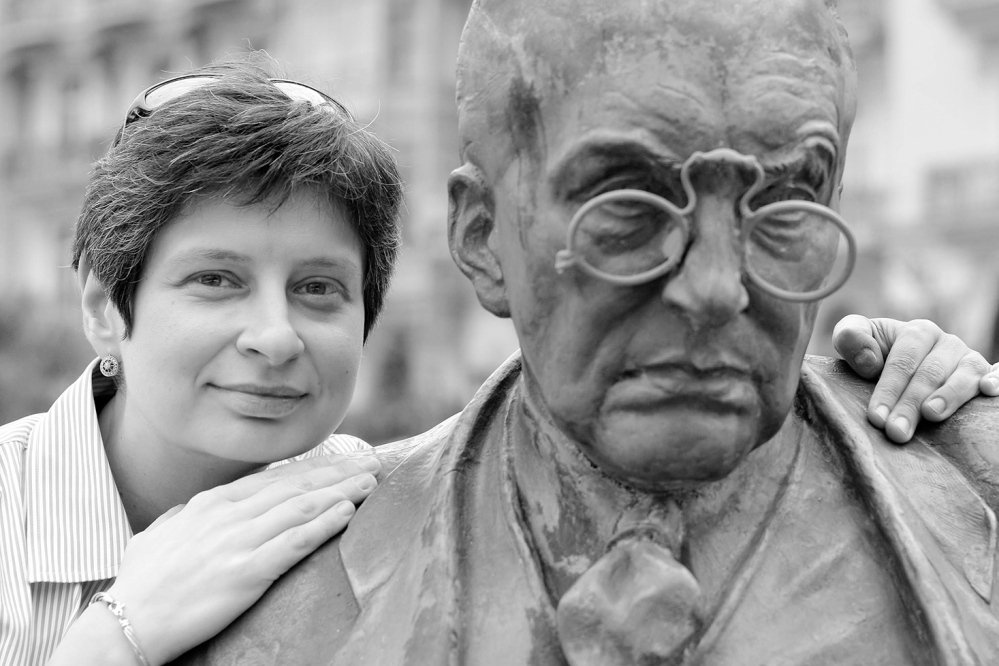UNDERSTANDING PUTIN: Nina Khrushcheva with the statue of the Russian novelist Vladimir Nabokov in Montreux, Switzerland, where the writer lived. The great-granddaughter of former Russian Premier Nikita Khrushchev is no fan of Vladimir Putin, who she predicts won't continue his march into and conquest of Ukraine because it would be too expensive.