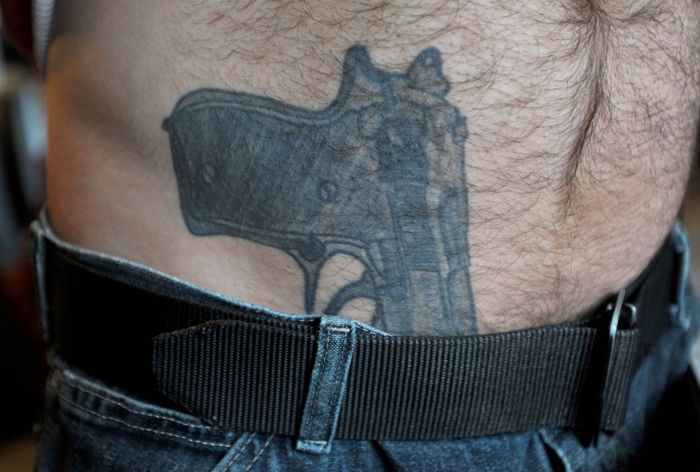 NOT LOADED: The tattoo of a 9-mm pistol that appears to be tucked in to the pants of Michael Smith prompted a police response at his Norridgewock home on Tuesday. The incident touched off a national media frenzy and online comments about gun rights, civil liberties and police actions.