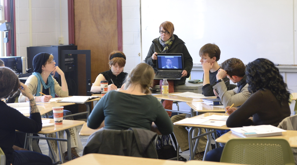 Professor Nancy Erickson plays a video during her French music class at USM in Portland. Faculty members say small classes allow for certain teaching methods, such as assigning papers, that can't be employed effectively in bigger classes.