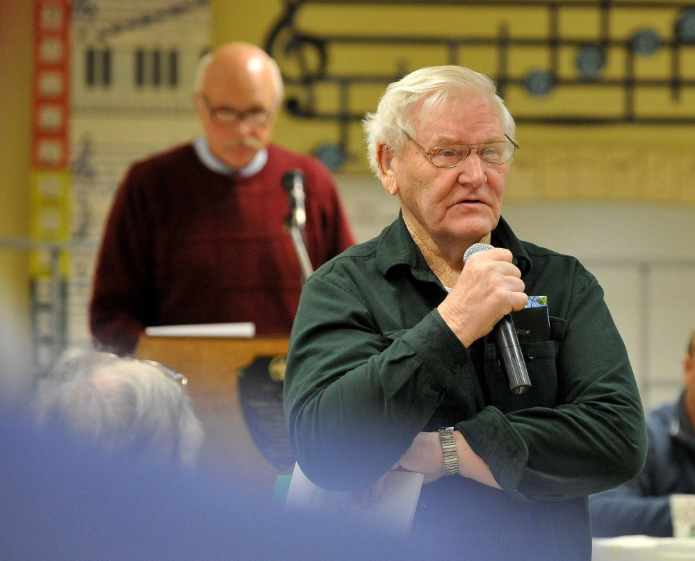 Speaking up: Lawrence Tibbetts offers his opinion about cemetery maintenance money during the Town Meeting Saturday morning at J.H. Bean Elementary School in Sidney.