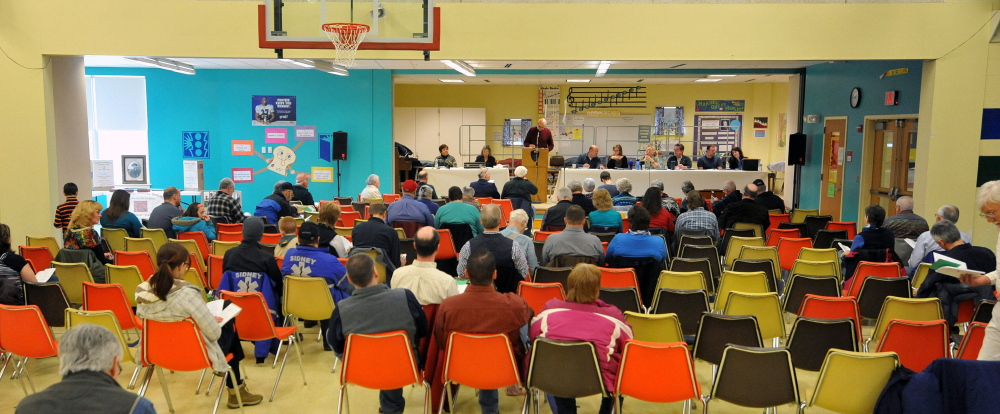 town meeting: Sidney community members gather at J.H. Bean Elementary School to approve the town's annual budget.