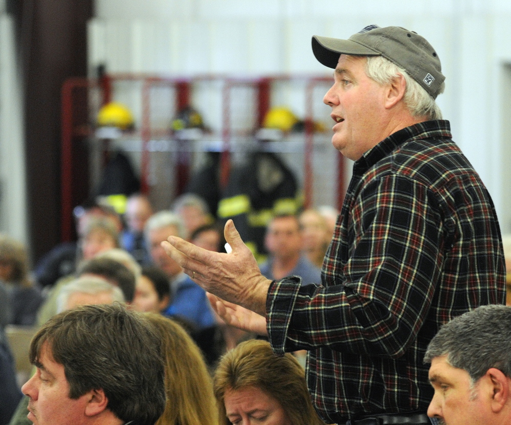 West Gardiner town meeting: Road commissioner Gary Hickey answers questions during debate about a warrant article on buying a new plow truck at the start of the 163rd West Gardiner Town Meeting on Saturday at the West Gardiner Fire Station.